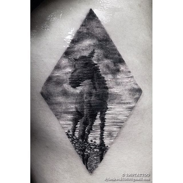 Unique tattoo of an horse's reflection on water.