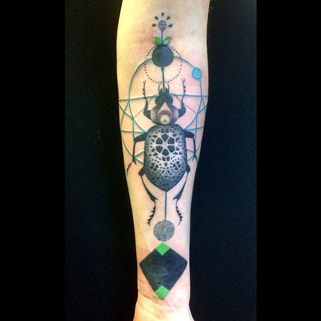 Awesome geometric pattern and beetle forearm tattoo by Amanda Chanfreau.