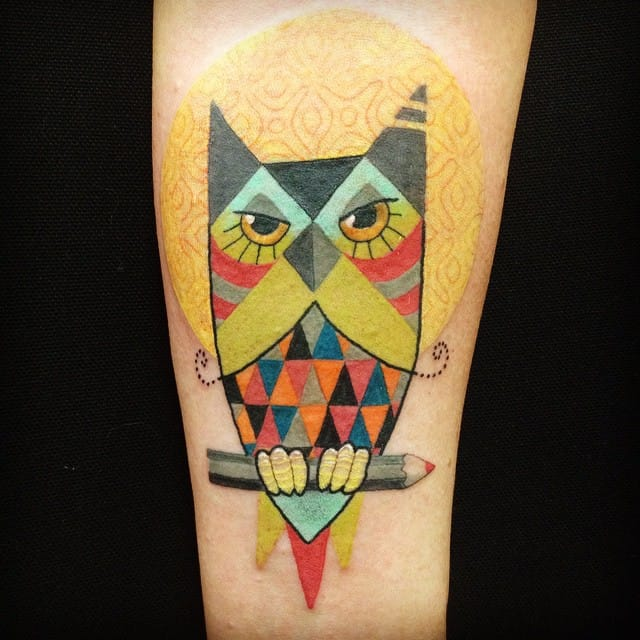 Owl perched on a pencil, tattoo by Amanda Chanfreau.