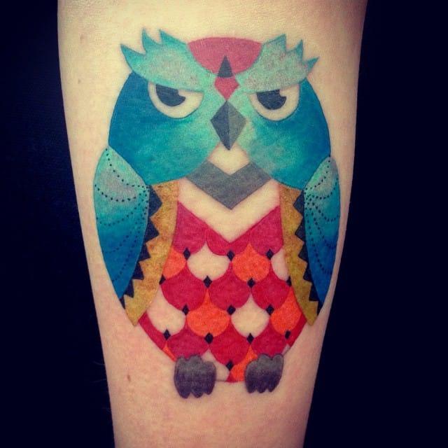 Awesome colorful owl tattoo by Amanda Chanfreau.