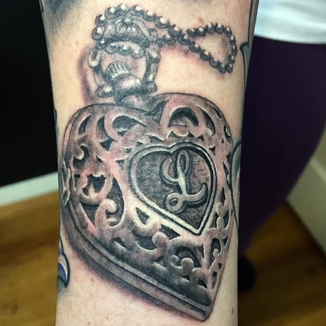 Realistic black and gray heart locket by Tattoo Tony