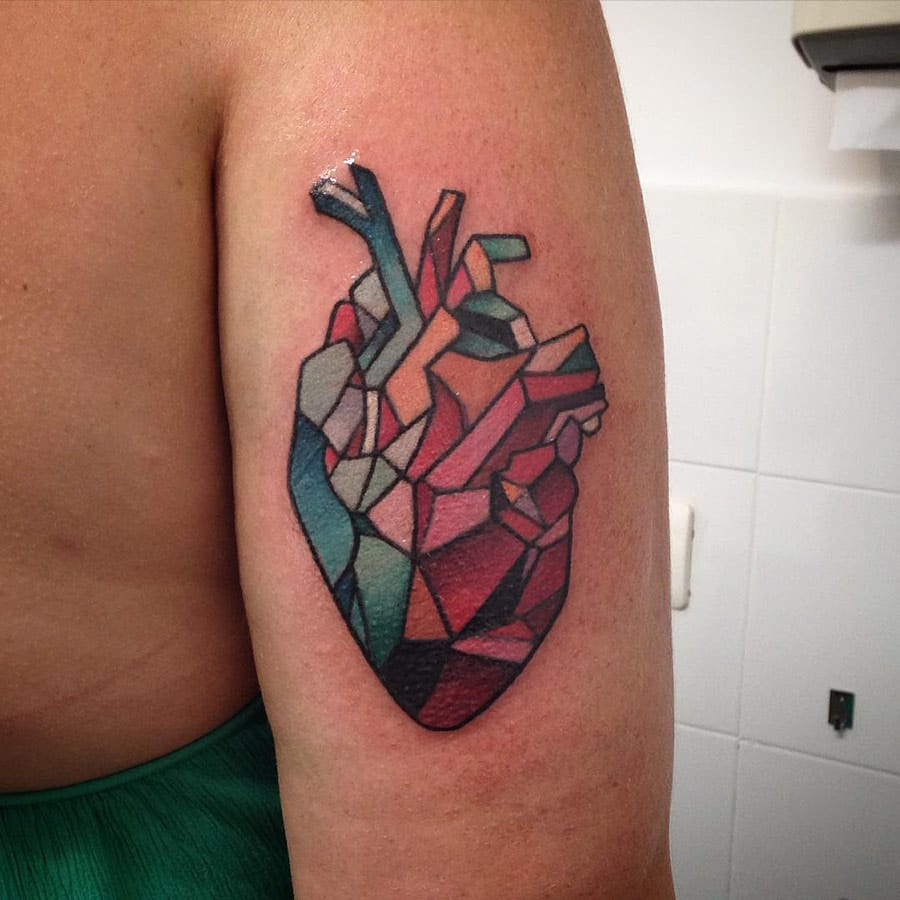 Love the color pallette of this Geometric Heart tattoo. Artist unknown.
