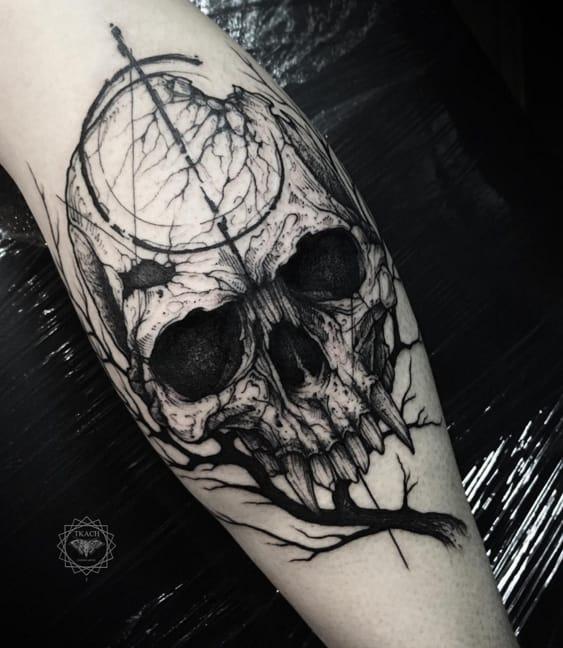 Creepy skull and branch tattoo. Photo: Instagram.
