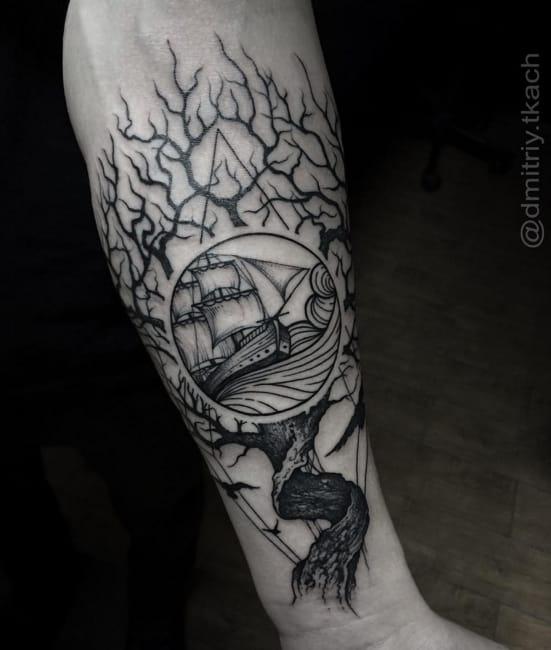 Ship and tree tattoo by #DmitriyTkach. Photo: Instagram.