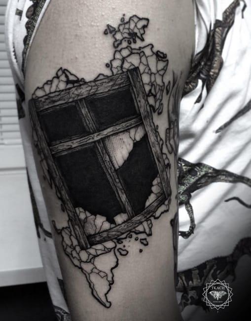 Broken window tattoo by #DmitriyTkach. Photo: Instagram.