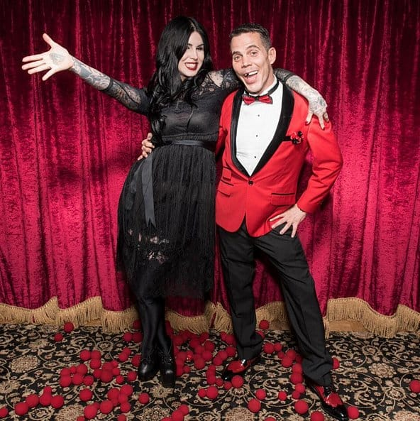 The tattoo artist and infamous prankster pose for photos inside Los Angeles' Magic Castle