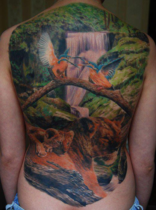 Full back hummingbird, lion and waterfall tattoo by Den Yakovlev
