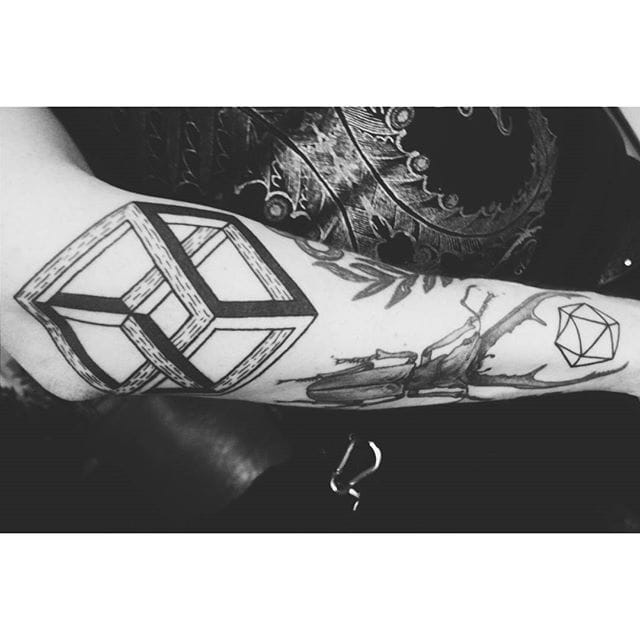 Cool blackwork Impossible Cube done by Bleck Tattoo