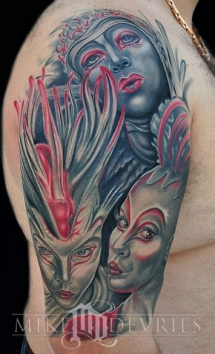 Gorgeous realistic tattoo by Mike DeVries inspired by the famous Cirque du Soleil!