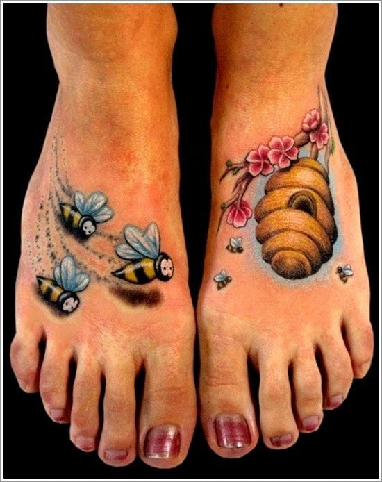 Pretty matching tattoo of bees & their hive placed on the feet. Artist unknown