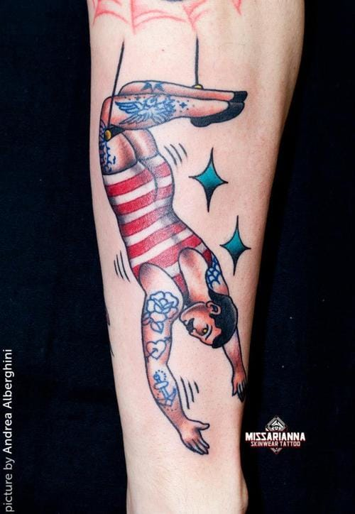 Trapeze tattooed guy by Miss Ariana.