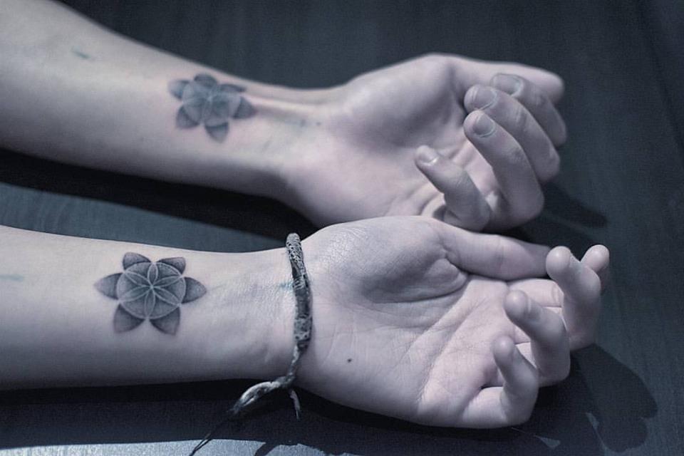 Matching tattoos via Placide Avantia.