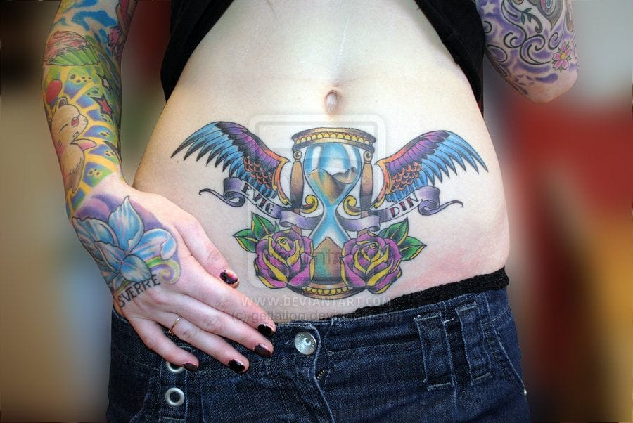 Colorful stomach piece by Charlie of Getatattoo.