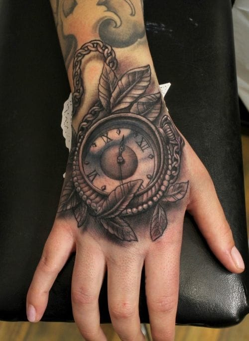 Nice Pocket Watch hand tattoo by Ion at Swahili Bob's tattoo, Sweden.