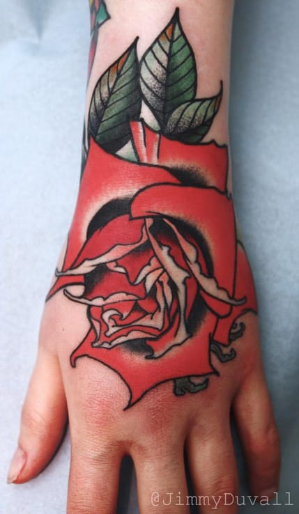 Red rose hand tattoo by Jimmy Duvall. Photo: Instagram.