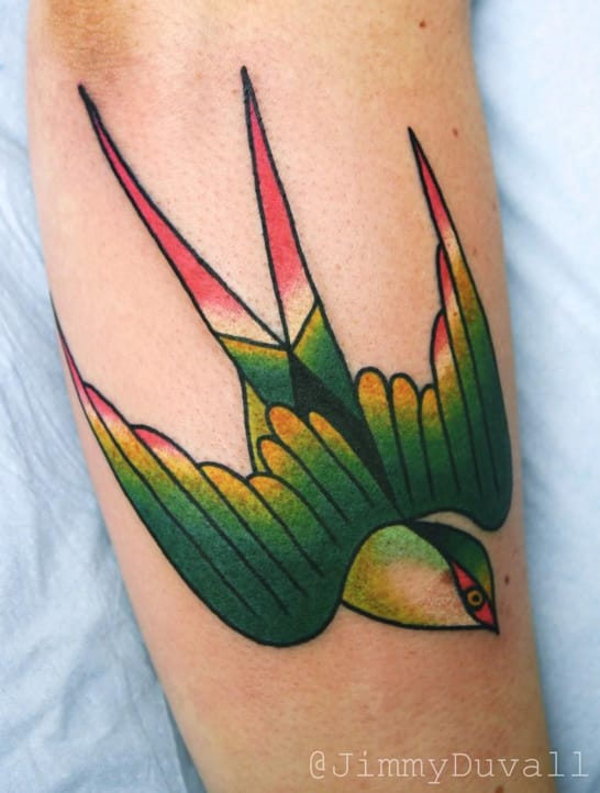 Creative use of colours in this traditional swallow tattoo by Jimmy Duvall. Photo: Instagram.
