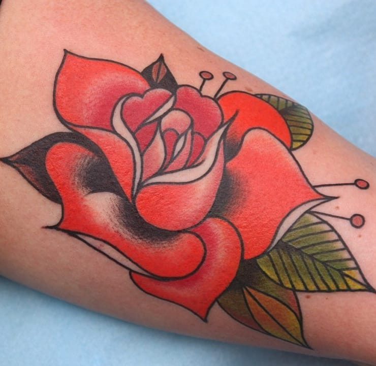 Love the addition of black petals in this red rose tattoo by Jimmy Duvall. Photo: Instagram.