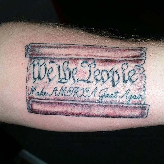 Is that a tattoo, or an actual scroll?! I can't tell!