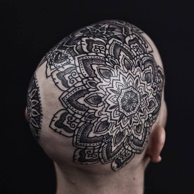 Mandala head tattoo by Thomas Hoope.