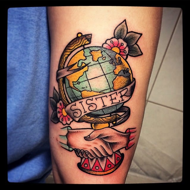 A beautiful traditional style tattoo showing unity #sister #globe #traditional