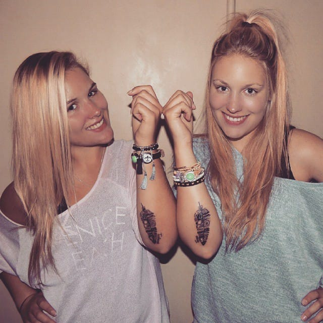 Matching black feathers sister tattoos #feather #sisters