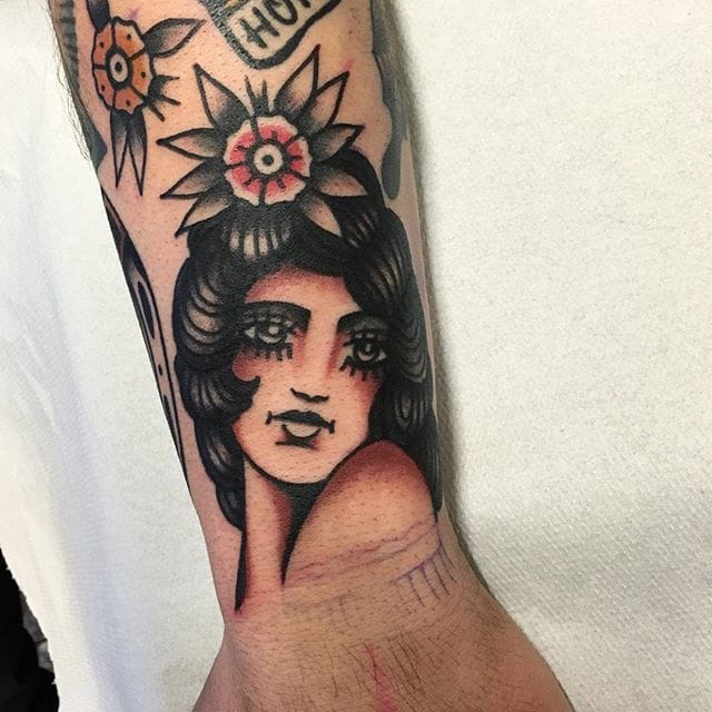 11 Stylish Traditional Girl Tattoos by Michele Ianni