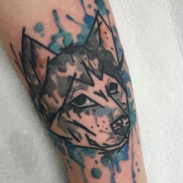 Husky tattoo by Mike Love and Clare Lambert.