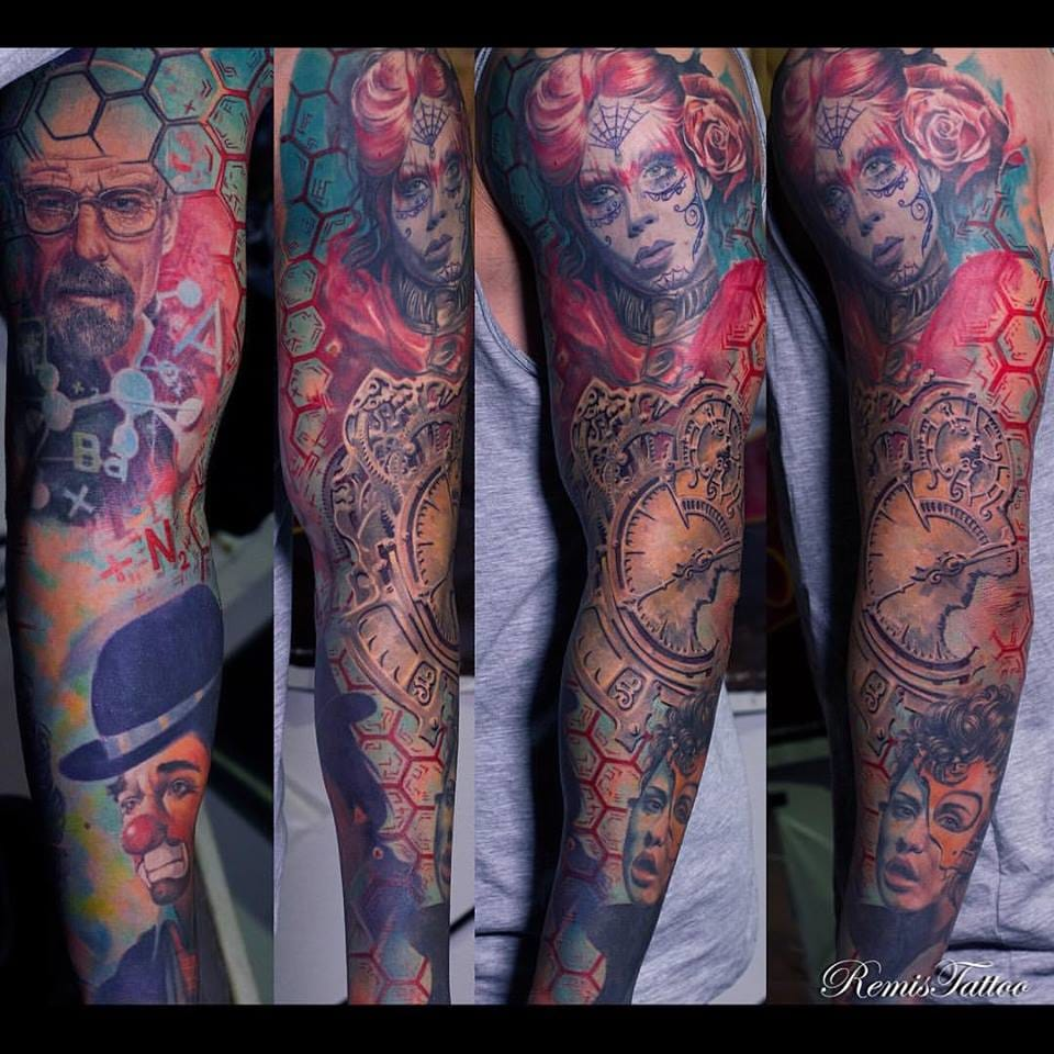 Colourful sleeve tattoo by Remis Tattoo. Photo: Facebook.
