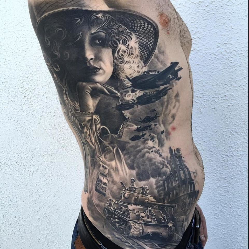 Black and grey war tattoo by Remis Tattoo. Photo: Facebook.