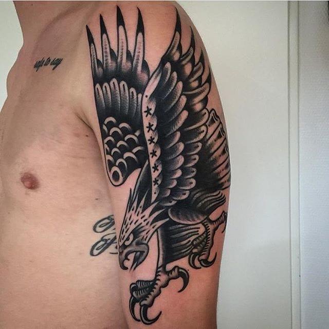10 powerful blackwork eagle tattoos tattoodo for Black eagle tattoo shop