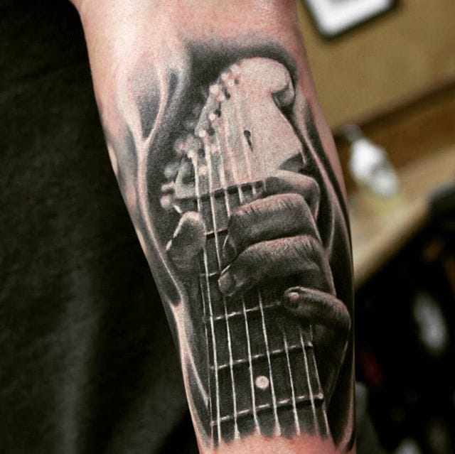 Black and grey tattoo by Richie Bon.