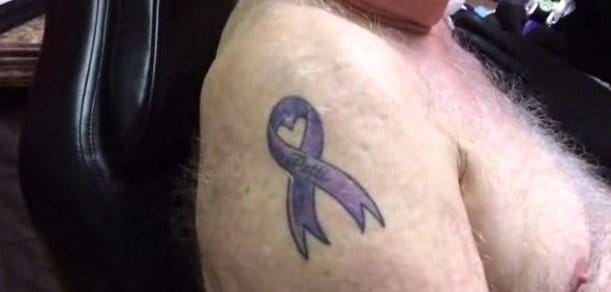 Arthur also has a tattoo for his wife Patti. The purple ribbon is in support of Alzheimer's research