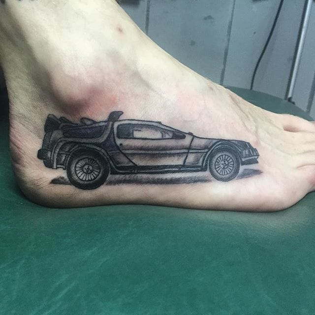 A DeLorean at your feet! Done at the Old Skulls Tattoo & Shop