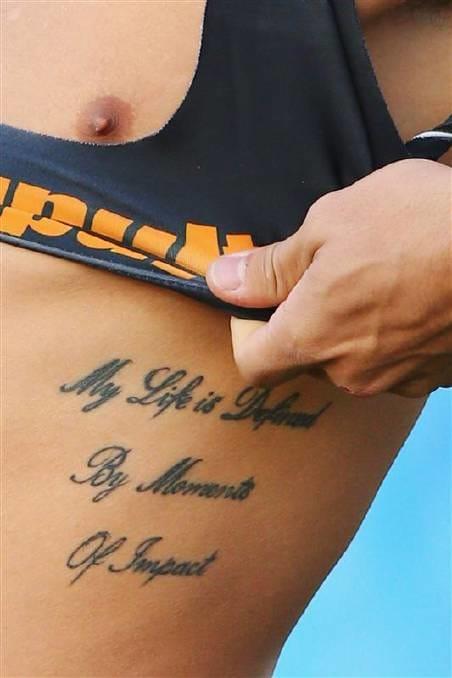 amazing sports photography of athlete tattoos tattoodo. Black Bedroom Furniture Sets. Home Design Ideas