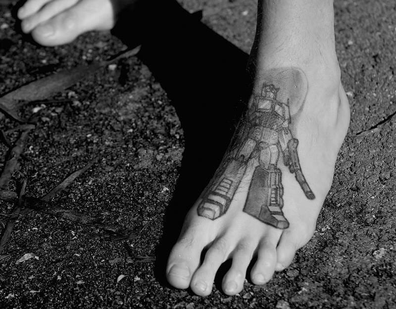 Stephen Thompson, triathlete from Ireland, has a Transformer on his foot! Photo by Michael Dodge/Getty Images