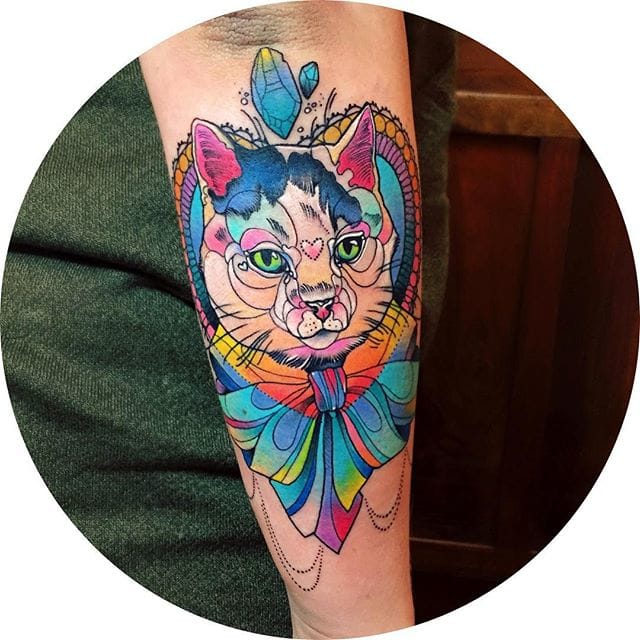 Colorful cat tattoo by Katie Shocrylas