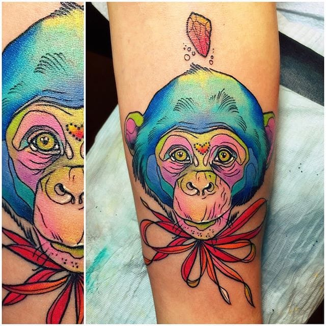 Awesome looking chimp tattoo by Katie Shocrylas