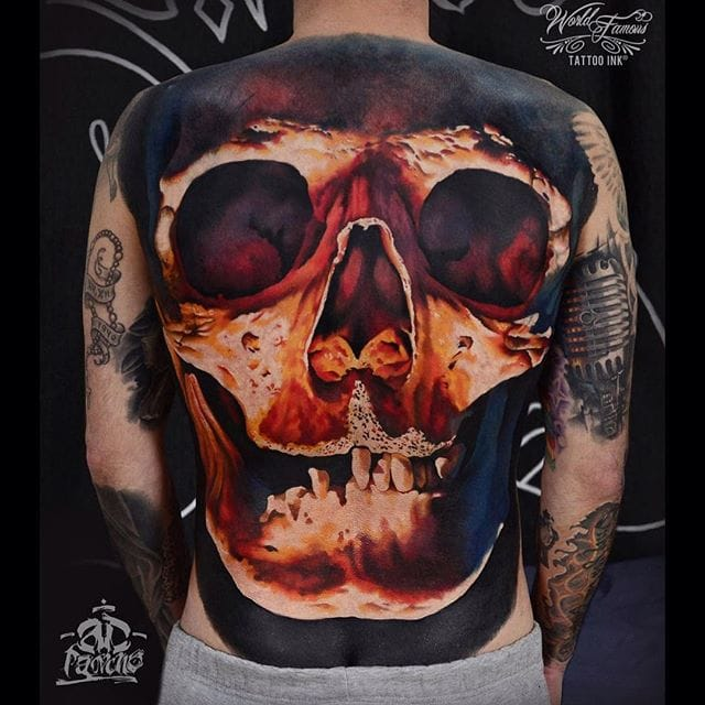 Stunning back tattoo by Ad Pancho