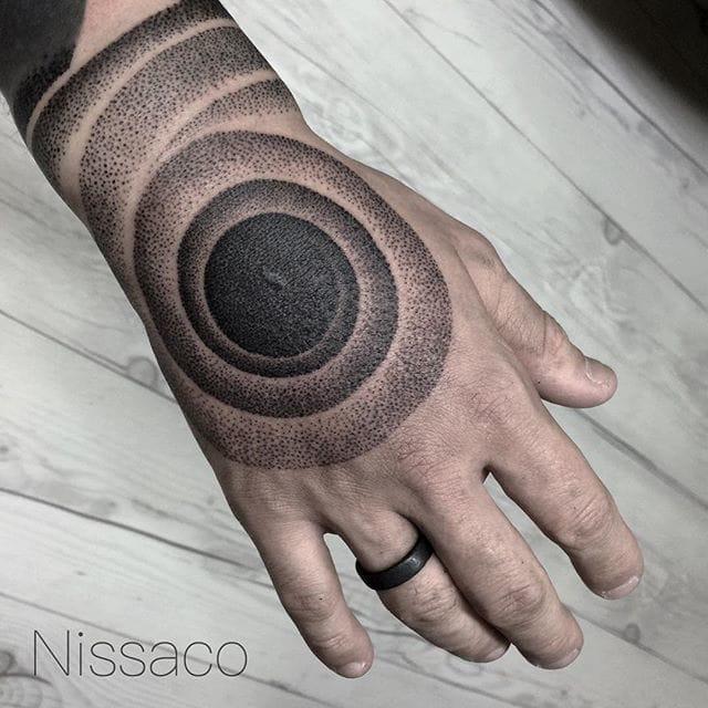 Pointillism hand tattoo done by Nissaco.