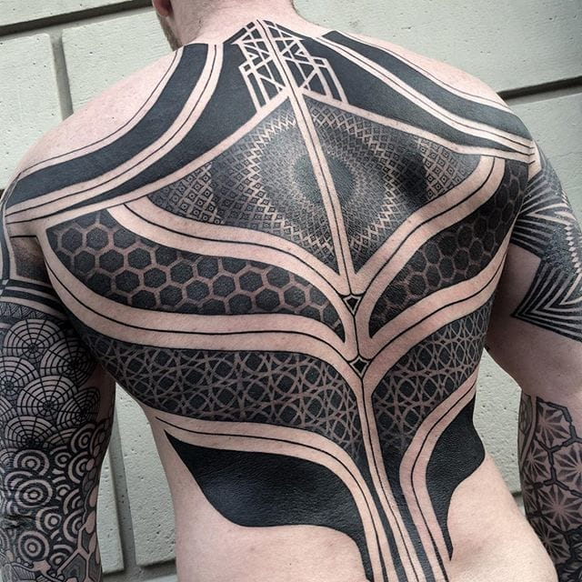 Amazing detail on this back tattoo by Nissaco