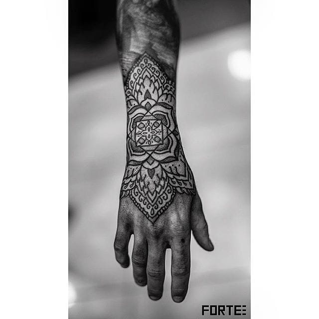 Awesome hand tattoo by Dillon Forte