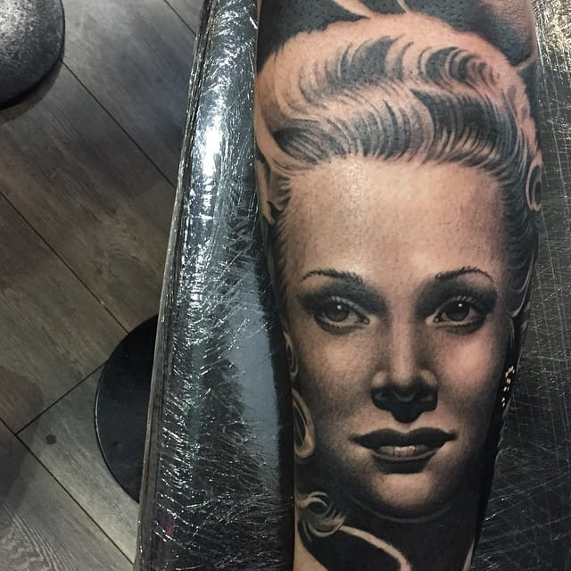 Feels like the face is breathing at you, tattoo by #RyanEvans