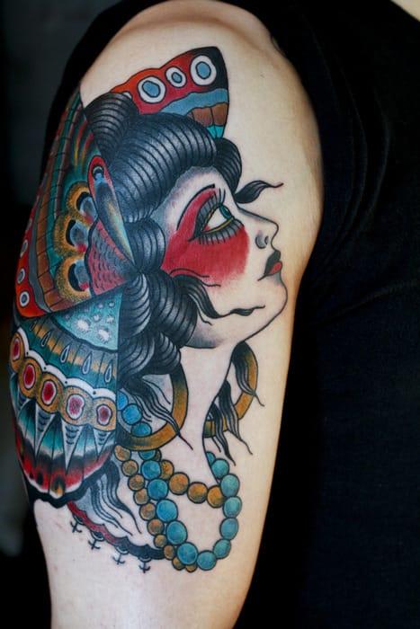 Vibrant butterfly lady portrait tattoo #ButterflyLadyTattoo