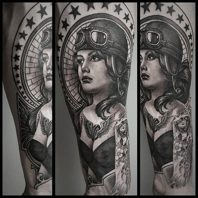 Black and grey tattoo by Chris Adamek.