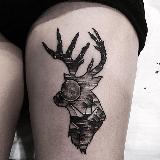 Blackwork deer tattoo.