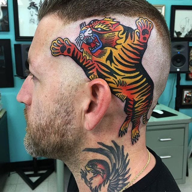 Tiger tattoo by #IsaiahToothtaher. Photo from @toothtaker