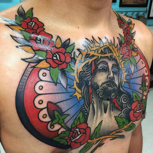 Chest Jesus Christ tattoo by #IsaiahToothtaher. Photo from @toothtaker