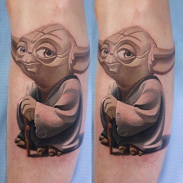 Green skinned Star Wars Alian tattoo by Denis Torikashvili
