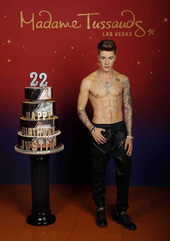Wax JB next to his 22nd birthday cake at Madame Tussaud's Las Vegas via Las Vegas Sun