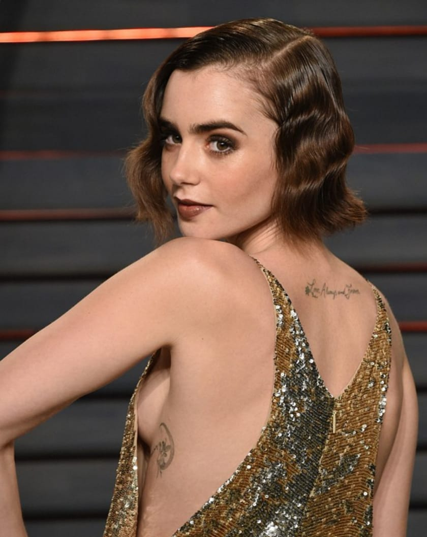Lily Collins Shows Off New Fairytale Themed Tattoo